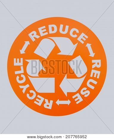 Photo of REDUCE, REUSE, RECYCLE sign. This photo was taken from sign board.