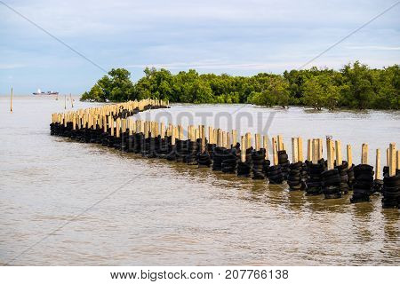 Sea wave protection barrier breakwater made from tire protect mangroove forest and coast