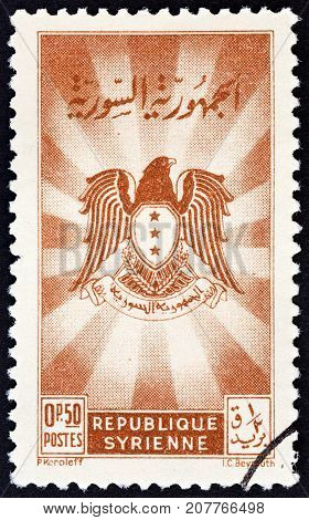 SYRIA - CIRCA 1950: A stamp printed in Syria shows Coat of Arms, circa 1950.