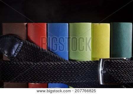 Multicolored book archive pulled by a belt