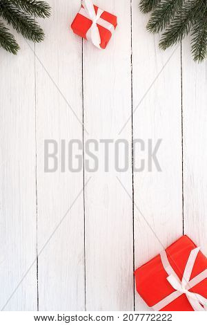 christmas and new year background christmas red gifts boxes and fir leaves with decoration rustic
