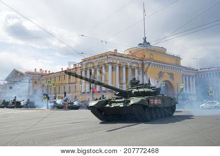 ST PETERSBURG, RUSSIA - MAY 09, 2017: Russian T-72B3 tank against the background of the Admiralty building. Fragment of the military parade in honor of the Victory Day