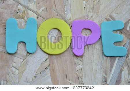 word hope on a  abstract colored background