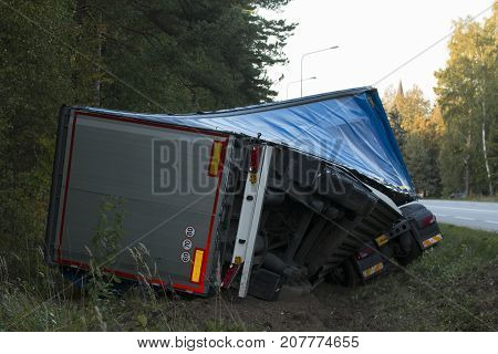 road accident lorry car crash on an highway lane road. Automobile in side ditch