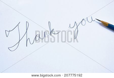 pencil write thank you word on white paper