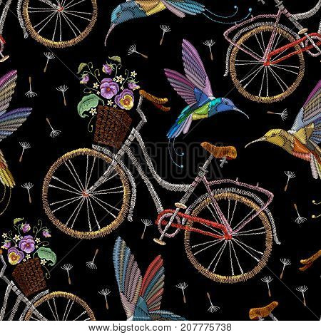 Embroidery bicycle violets flowers and humming birds seamless pattern. Fashionable summer pattern embroidery bicycle humming bird and violets romantic art template clothes