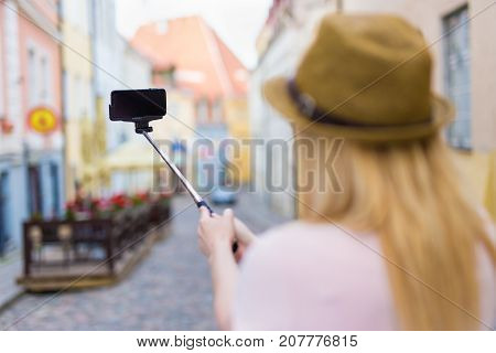 Travel And Photography Concept - Young Woman Tourist Taking Photo With Smart Phone