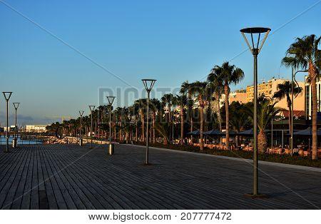 Walkway along the sea, palms, streetlamps, wooden bridge,  Cyprus.