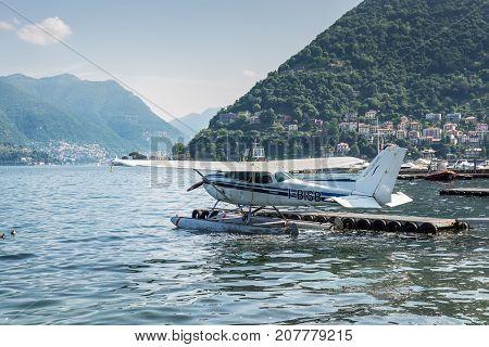 Como Italy - May 27 2016: A seaplane of the Aero Club Como docking on at water aerodrome of Como lake in Como City Italy.