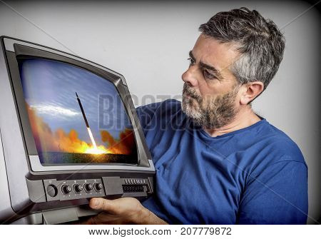 Man watches television old news launch missile in World War Three