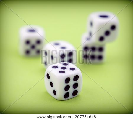 Several dice together isolated on green background