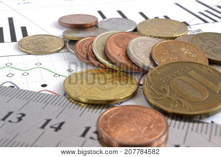 Financial background with money graph and ruler.