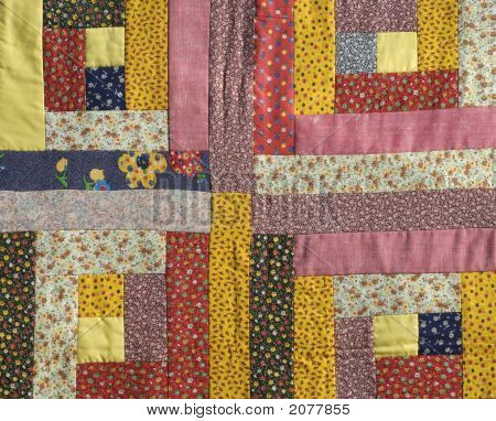 Handmade colorful padded pattern patchwork folksy multicolored quilt. poster