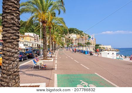 Palm trees white benches and cycle paths on Quai des États-Unis - Nice, France, 9 July 2013
