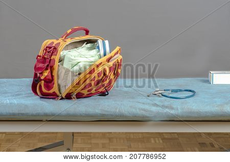 Doctor's Bag And Stethoscope Over A Stretcher.