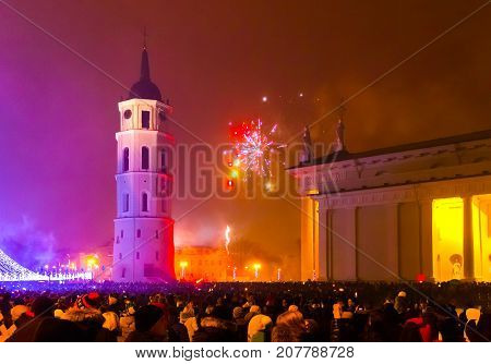 Vilnius, Lithuania - January 01, 2017: The main firework in Lithuania at New Year at Vilnius, Lithuania on January 01, 2017. The most interesting and popular viewpoint to historical disrict of Vilnius with Gediminius tower.