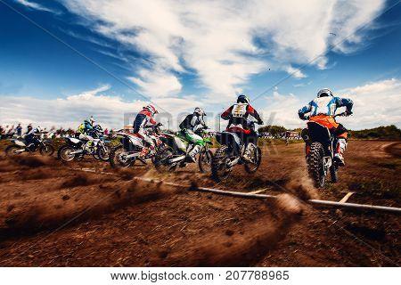 Motorcycle. Team athletes on mountain bike motorcycles on motocross start
