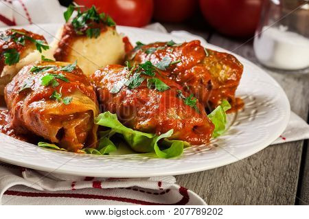 Stuffed Cabbage With Meat And Rice Served With Boiled Potatoes And Tomato Sauce