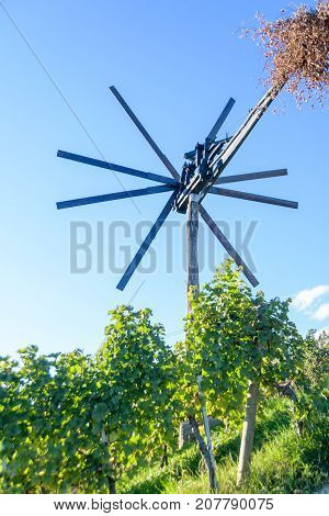 Klopotec, authentic traditional windmill in Slovenia found in vineyards to scare off birds, wine road and local attraction unique to Slovenia