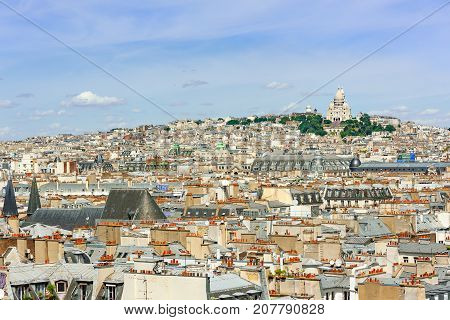 Paris roofs with Montmartre and the Sacre-Coeur in the background, France