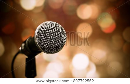 Blurred of microphones in seminar room talking speech in conference hall light with microphone and keynote. Speech is vocalized form of communication humans.