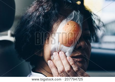 Patient Asian Women Show Her Eyes With Eye Shield