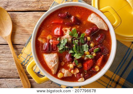 Traditional Chicken Chili Stew With Beans, Corn And Tomatoes Close Up. Horizontal Top View
