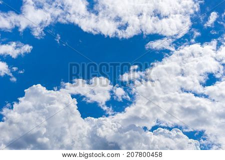 View on beautiful white Clouds on a Blue Sky. Close-up of Big Skies in the Morning. Cloud Formations. Nature and Cloud Backgrounds.