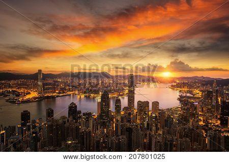 Day to night for Hong kong city sunrise and Hongkong harbor from victoria peak Hongkong city China