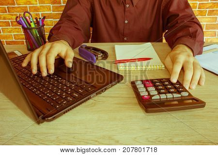 Business man doing finances on calculate analysis working with financial results Financial accounting sales forecast graph. Businessman Calculating Invoices Using Calculator - Retro color