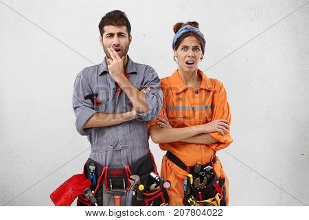 Discontent Handyman And His Female Partner Look At Object They Should Repair, Realize All Difficulti