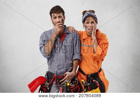 Portrait Of Untidy Service Workers Do Well Repair Work Or Constructional Equipment, Have Dissatisfie