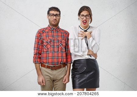 Displeasure, Dislike And Disgust Concept. Portrait Of Male And Female Have Squeamish Disgusted Look,