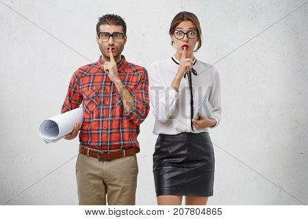 Be Silent! Energetic Enthusiastic Female And Male Engineers Work Together, Show Silence Sign, Ask To