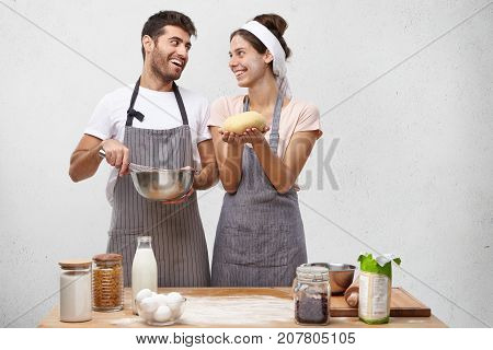 Glad Housewife Feels Proud, Holds Well Made Dough, Shows To Husband, Going To Continue Baking Bun. J