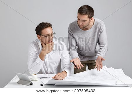 Creative Male Designer Wears Casual Sweater, Presents His Ideas And Designing Project To Employer, T