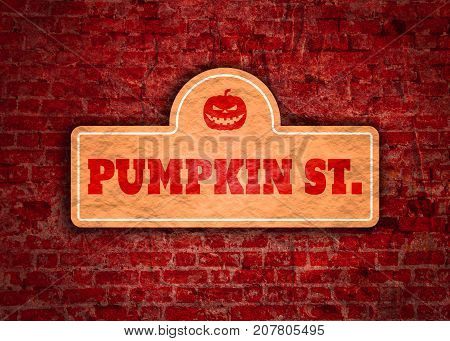 Vintage styled house nameplate with Halloween symbol icon and Pumpkin st text. Ancient brick wall grunge texture