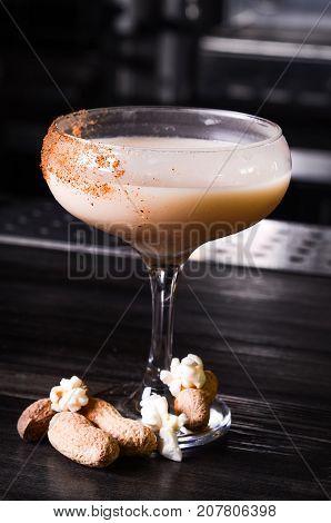 Baileys liqueur in glass on dark background. bar alcohol cocktail menu Milk liqueur. evening club concept
