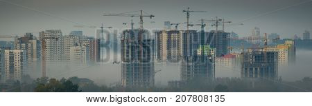 Overpopulation concept - construction of new block bulidings, fog, toned, Kyiv, Ukraine