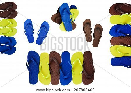 Several pairs of multi-colored rubber flip-flops exhibited in a row isolated.