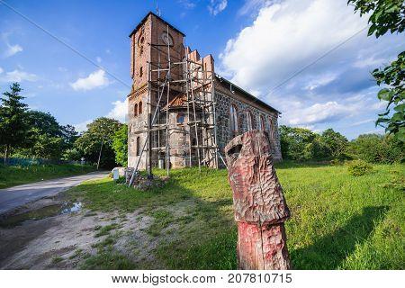 Bricks and stones church in small village Stare Brynki West Pomeranian Voivodeship in Poland