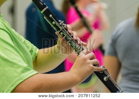 the hands of a musician playing a clarinet