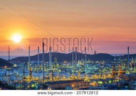 Oil tank and oil refinery factory in Thailand with smoke and frame from refinery process industrial power energy and environment concept