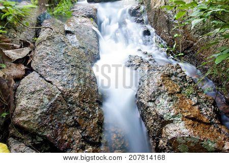 Nature of small water fall from mountain at Khao Phu Don Sam Nak Thon, Ban Chang Rayong Thailand.