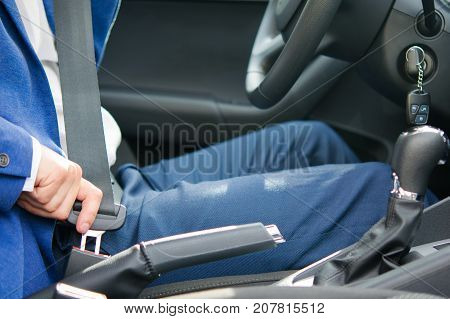 the process of fastening the safety belt by the driver before the trip