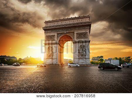 Cloudy sky and Arc de Triomphe in Paris, France