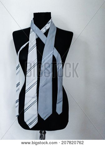 Black mannequin with ties on a white background
