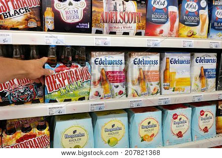 GRAND EST, FRANCE - AUGUST 16, 2017: Several brands of beer in an alcoholic beverage aisle of a french Super U supermarket.