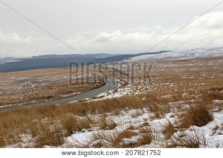 Icy driving conditions on the road through the Brecon Beacons