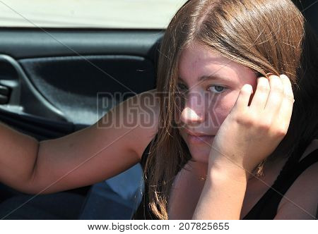 Female beauty driving her new car for the first time.